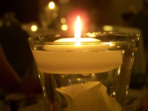 lit votive candle
