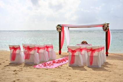 wedding arch, chairs on beach