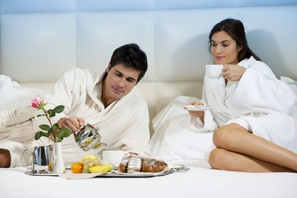newlyweds having breakfast in bed