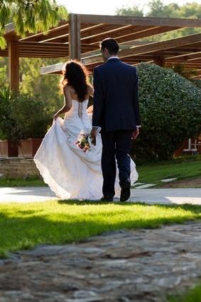 newlyweds walking outdoors