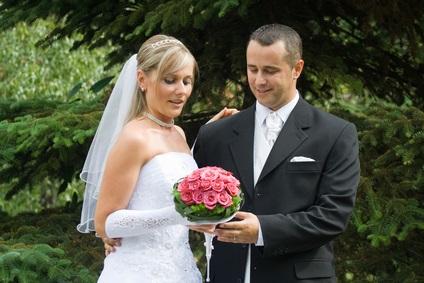 bride, groom holding bridal bouquet