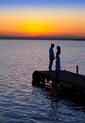 newlyweds at lake sunset