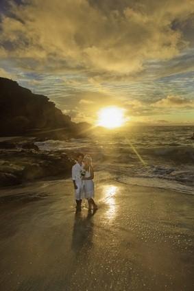 newlyweds at ocean sunset