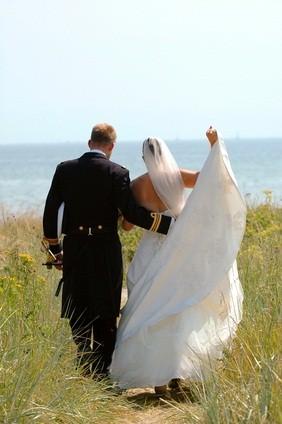 newlyweds walking to beach