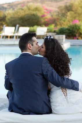 newlywed kiss by pool