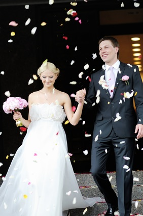 newlyweds and rose petals