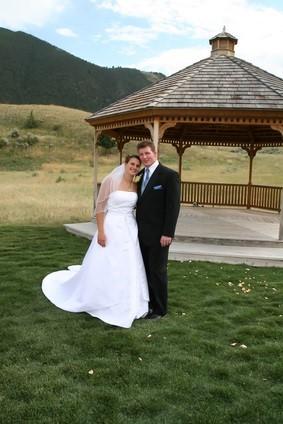 newlyweds by gazebo