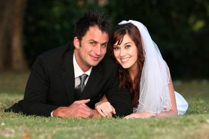 newlyweds on grass