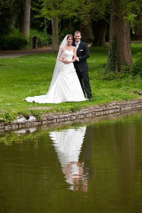 newlyweds by lake
